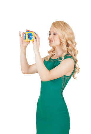 the beautiful blonde in a green dress photographs the toy camera photo