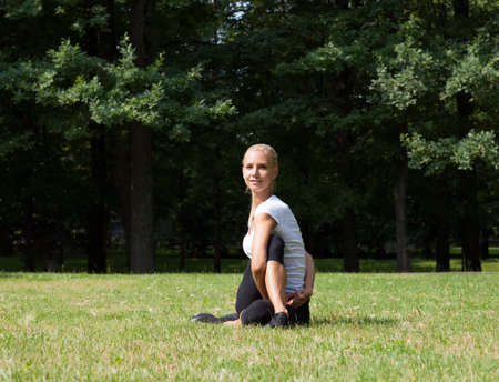 Beautiful woman doing yoga exercises photo