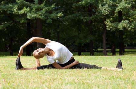 Beautiful woman doing yoga exercises photo
