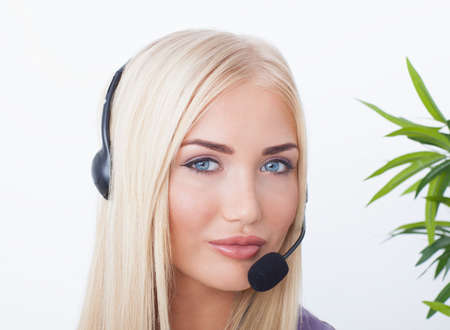 beautiful blonde, female customer service operator using headset photo