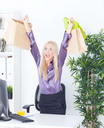 the young woman at office with beautiful bags photo