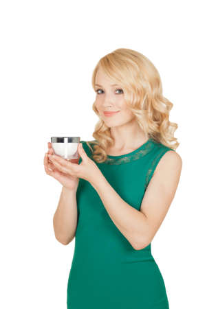 beautiful blonde holds a cream jar in a hand