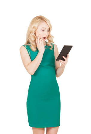 The beautiful blonde in a green dress with a tablet in a hand photo