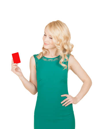 the beautiful blonde in a green dress holds a card photo