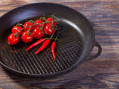 fry pans and fresh vegetables photo