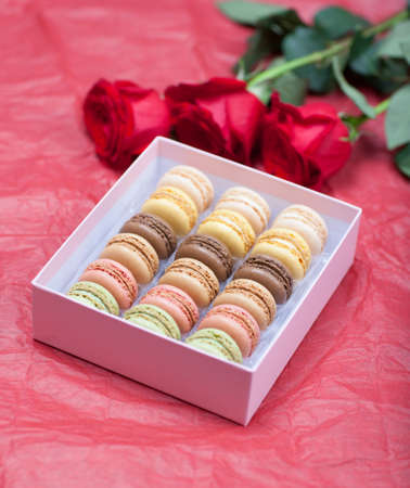 Macaroon on a paper background with roses photo