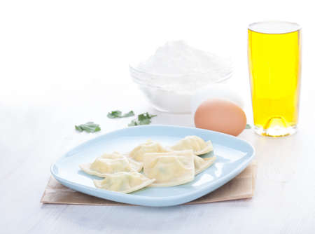 Homemade ravioli on a blue plate photo