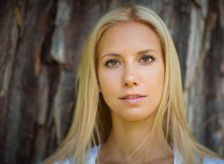 Portrait of the beautiful young woman of the blonde with long hair. Toned in warm colors photo