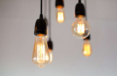 Decoration antique edison led light style filament light bulbs , graphic of wire background and copyspace on top,color vintage style. Warm.