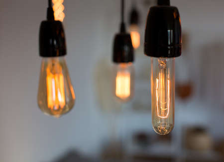Edison lamp with warm light sways lightly background. Warm.