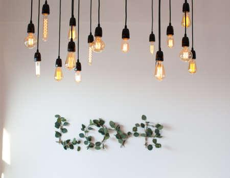 Set edison retro lamp on loft gray concrete background. Concept idea. Love. Warm.
