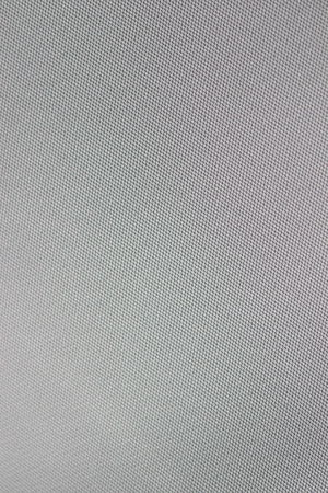 Gray fabric texture stretched. The ceiling is in the car. Gray texture. Smooth surface of the fabric.