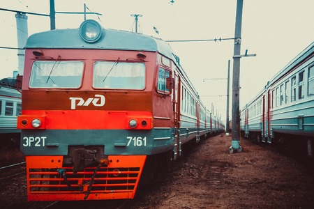 in the depot of steam locomotives, electric locomotives on railway tracks. Electric trains are in the depot. St. Petersburg, Russia, summer 2016