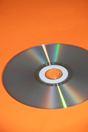 dvd disk on an orange background. CD. isolated object