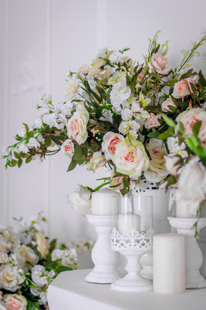 Wedding bouquet of white roses in a vase. Wedding decorations. White Rose. Wedding Attributes