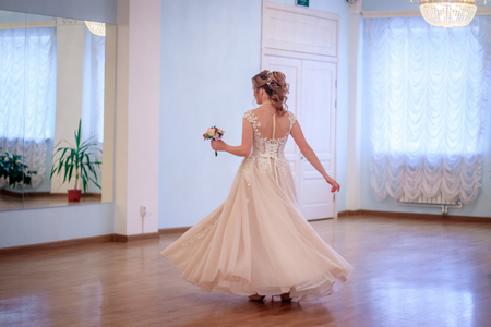 The bride is spinning in the dance.
