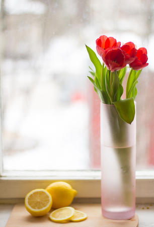 Red tulips in a vase. Postcard to the international womens day. March 8. Stockfoto
