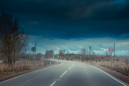 Spring road outside the city. Russia, roads in the fields. Bypass road