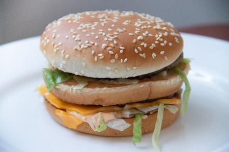 Big burger. Food fast food restaurant. Wrong food. Cholesterol and obesity