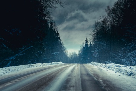 Snowy winter road. The road is covered up. Russian dear. Winter fairy tale out of town
