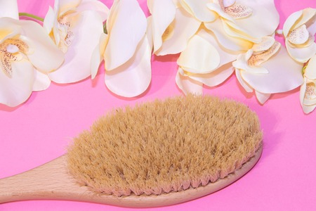 Brush for dry massage. New cosmetology. Getting rid of cellulite and stretch marks. Proper skin care. Spa treatments. Skin youth