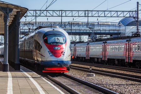 High-speed train Sapsan. Fast speed Travel Moscow - St. Petersburg. Station Lyuban, Russia, Leningrad Region April 7, 2018