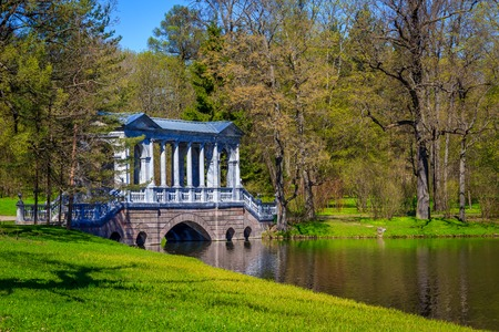Bridge in the spring in the park. Bridges Russia. Park Russia. Old bridge. Crossing the river