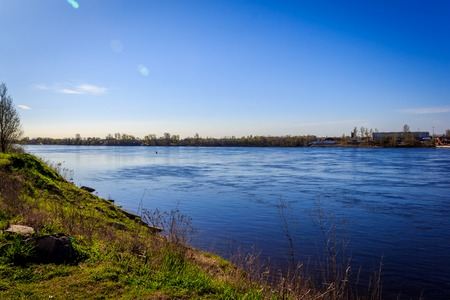 Neva River outside the city. Wide river. River in the village. Strong current