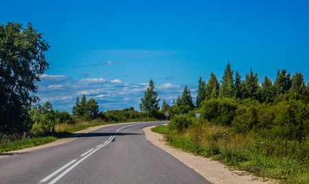 Russian asphalt road out of town. Travelling by car. Road views Banco de Imagens