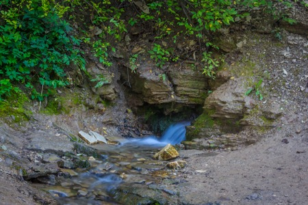 A small waterfall. Waterfalls in the outback of Russia. Water flows down. Water flow 写真素材