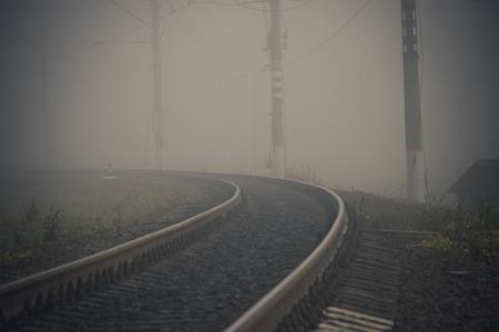 Fog on the railway. Foggy Russian railway. Morning fog. Heavy fog Фото со стока