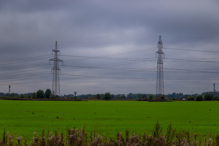 Electricity poles in the field. Electricity travels by wire. Russian electricity in the field