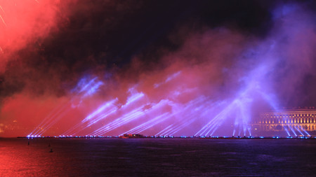 Fireworks over the river. Bright laser show. Holiday in the city. Summer performance