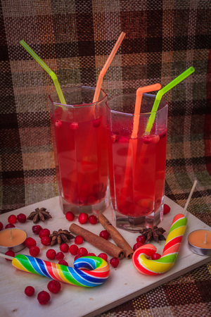 Cranberry juice in glasses. Healthy drink. Red drink in glasses. Glass with a straw Reklamní fotografie