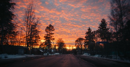 Unusual beautiful sunset over the road. sunset and road. Beautiful sky