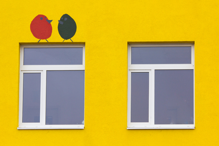 Colored building. Kindergarten. Drawing on the building. Russia, Leningrad region, Gatchina October 13, 2017