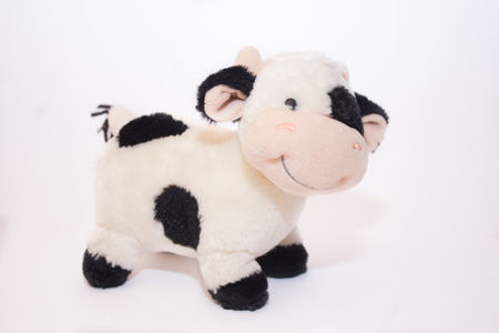 Soft toy cow isolated on white background. Isolated object. Children's toy Banque d'images - 122655540