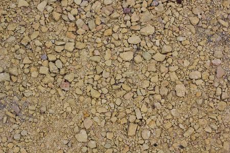 Piedras de fondo de textura en la carretera. superficie áspera