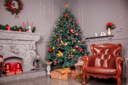 The decoration of the Christmas decorations small living room. Gray living room. Red scenery
