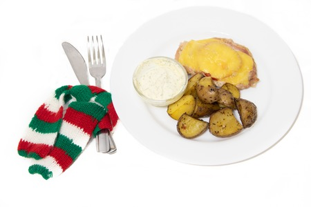 Baked potato and chop on a plate isolated on white background. food. hot meal 免版税图像