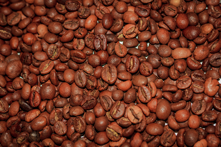 Coffee beans texture. Background wholegrain coffee. Brown background Foto de archivo - 122752490