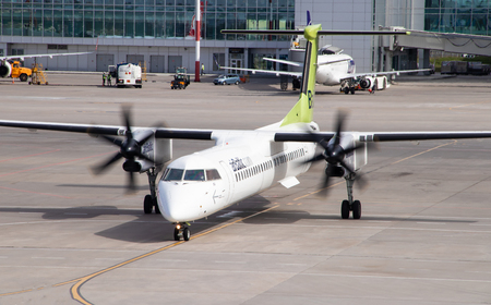 The plane goes to the airport. Air Transport. Transportation of people. Public transport. Airbaltic airplane. Russia, St. Petersburg, Pulkovo, official spotting on August 15, 2018 Éditoriale