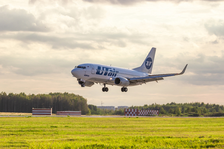 Airline UTair. Airplane at the airport. The plane is landing. Russia, St. Petersburg, Pulkovo, official spotting on August 15 2018 Editorial