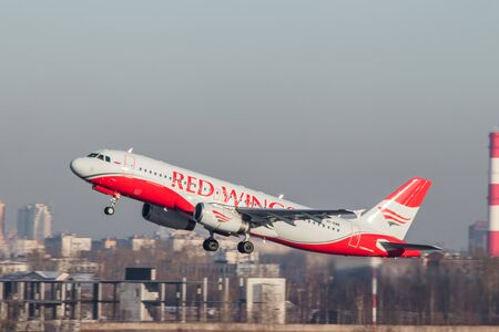 Airplane at the airport. Preparing for the flight. Passenger aircraft. Airline Red Wings. Autumn. Official spotting at Pulkovo Airport, St. Petersburg Russia November 28, 2018
