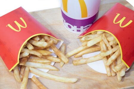 McCombo, fast food. Big Mac, French fries and lemonade. Not proper nutrition. Isolated food. Big poppy isolated on white background. Russia Leningrad region, Gatchina March 5, 2019