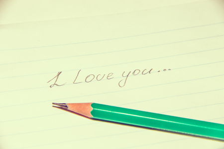 Text in pencil on paper I love you. Declaration of love on paper. Text on paper. I love you. Text writing
