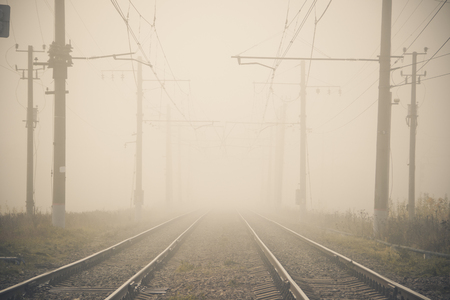 Russian railway. Rails sleepers contact network. Journey. Railway in the fall. Plants near the railway