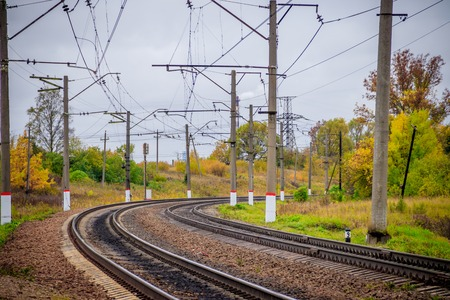 Russian railway. Rails sleepers contact network. Journey. Railway in the fall. Plants near the railway