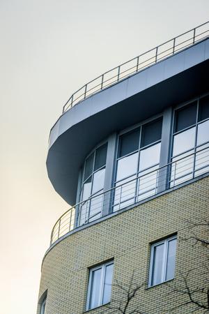Windows of a high multi-storey residential building. High building. Residential high-rise building. Many windows