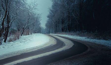 Winter Russian asphalt road. Winter road. Snowy road. Journey . Winter landscape